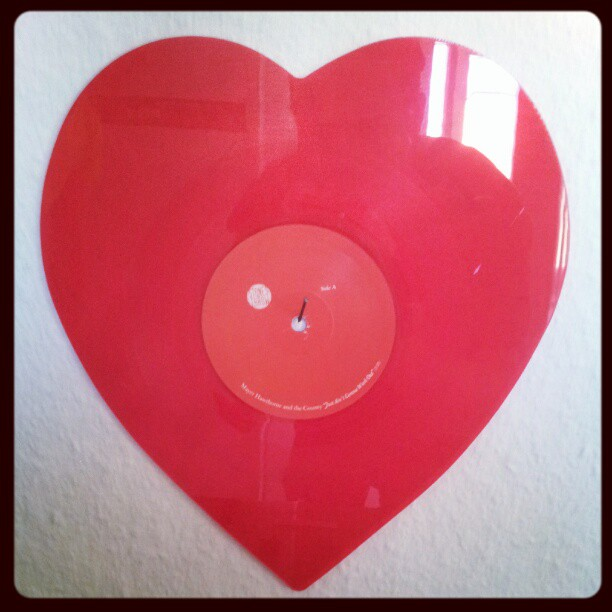 Love is vinyl and red.